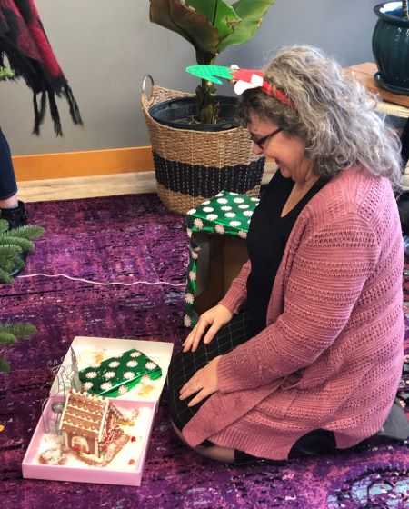 debra enjoys the start of her Christmas village and a book